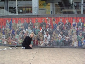 Genene in front of the Mural at Docklands