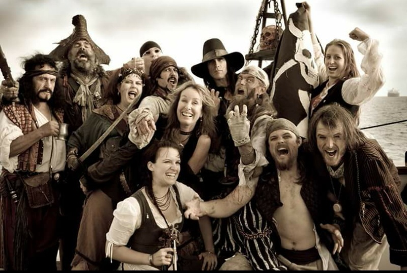 RORY FLYNN, center, surrounded by Pirates in Hobart, Tasmania, for her father's 100th birthday celebration in 2009!