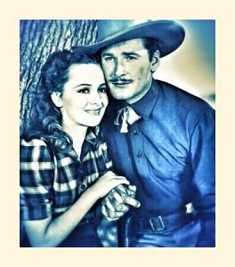 ca. 1939 --- Olivia de Havilland and Errol Flynn in a publicity shot from the 1939 film . --- Image by ?? Bettmann/CORBIS